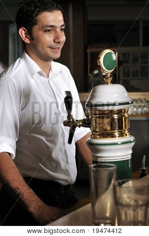 Bartender pouring beer from tap - a series of BAR images.