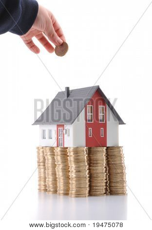 Invest in real estate concept - a series of COIN HOUSE images.
