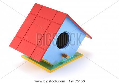 Handmade bird house isolated on white background.