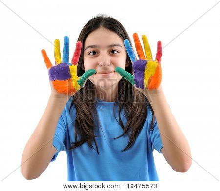 Teen girl with hands painted in colorful paints ready for hand prints - SEE MORE RELATED IMAGES.