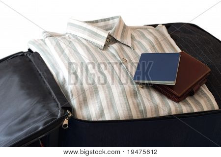 Clothes, Wallet And Passport In Suitcase (isolated on White Background)