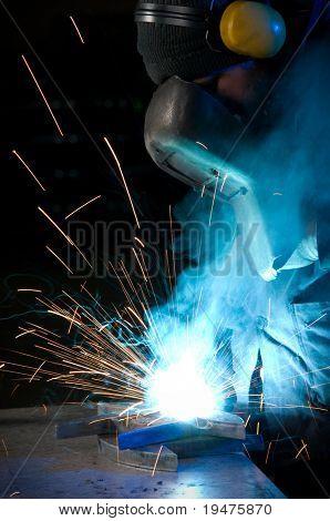 Worker welding steel - a series of METAL INDUSTRY images.