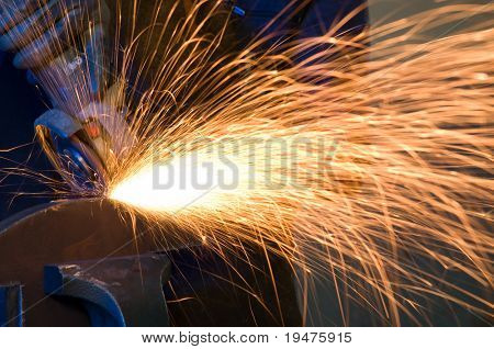 Cutting metal causing sparks isolated - a series of METAL INDUSTRY images.