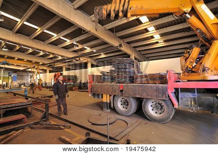 Motion blurred worker loading truck - a series of METAL INDUSTRY images