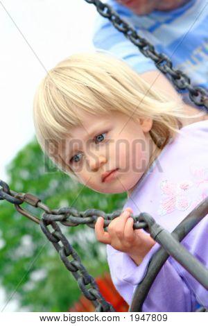 Toddler Girl On Outdoor Swing