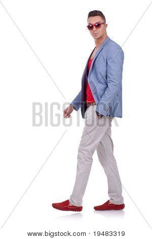 Fashion Man Walking And Looking At The Camera