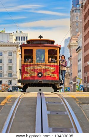 SAN FRANCISCO - NOV 26: Passengers enjoy a ride in a cable car on Nov 26, 2010 in San Francisco. It is the oldest mechanical public transport in San Francisco which is in service since 1873.