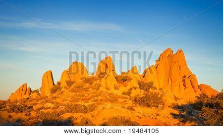 Rocks in Joshua Tree National Park illuminated by sunset, Mojave Desert, California