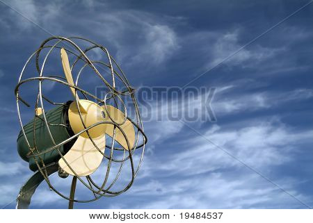 retro ventilator/fan against blue sky with cirrus clouds