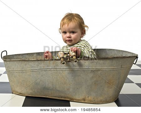 baby in an old bathtab with binoculars
