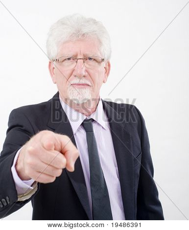 "senior businessman pointing a finger in a ""we want you"" gesture"
