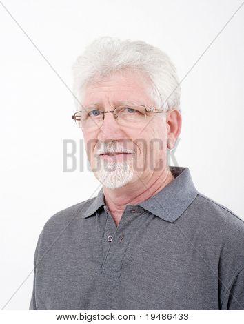 portrait of a smiling senior man over white
