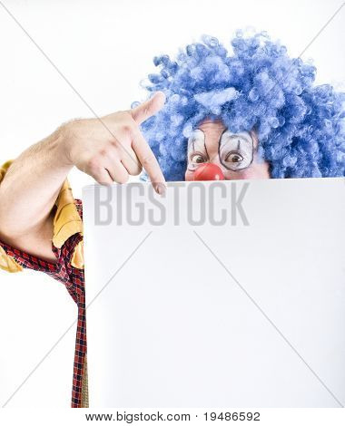 clown holding sign isolated on white