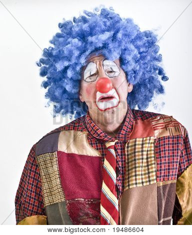 sad clown with blue wig and red noise isolated on white