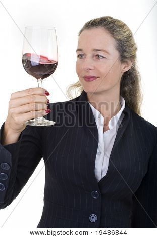 Smiling European business women in her 40's with wine glass isolated on white