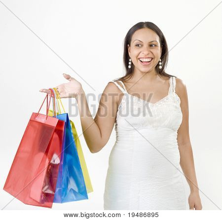 happy pregnant woman with shopping bags isolated on white