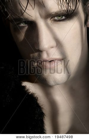 Extreme close-up portrait of young male goth model