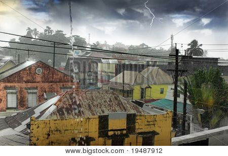 A tropical rainstorm over simple village with tin roofs