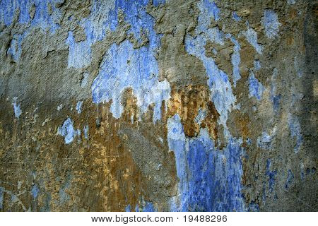 Old wall. Pieces of a paint on a surface.