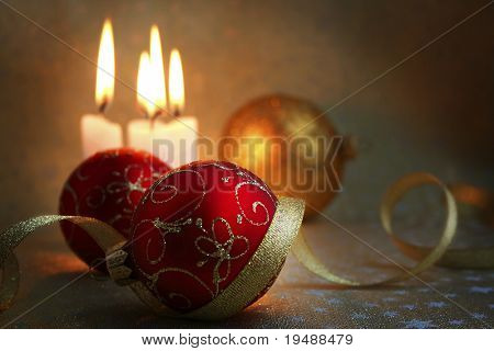 The burning candles, balls and gold ribbons it are Christmas