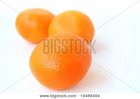 three ripe delicious mandarines on a white background