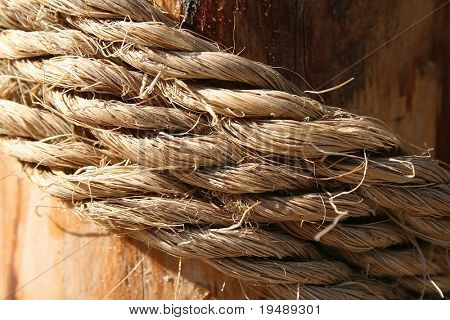 Rope on a wooden surface / macro