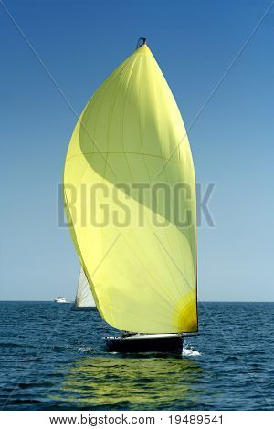 Sailing yacht with spinnaker in the wind / beautiful image