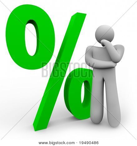 A man is thinking in front of a green percentage symbol, representing the comparison between different interest rates or statistics