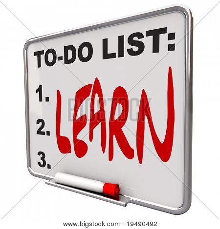 A white dry erase board with shiny metal frame and the words To Do List - Learn on it, symbolizing the importance of education and training to succeed in life and reach your goals