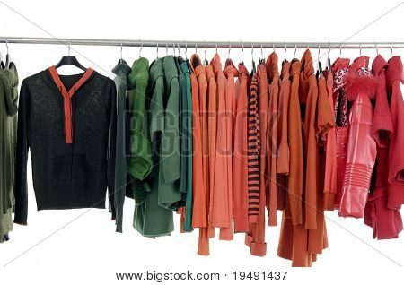 Line of fashion red clothes rack on hangers