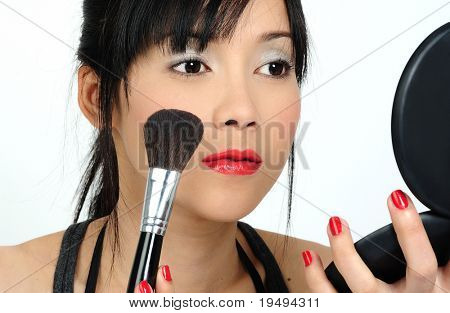 Young asian Woman doing Make up