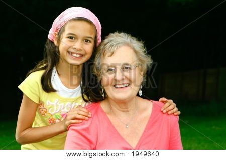 Young Girl With Her Grandmother Enjoying The Outdoor Park