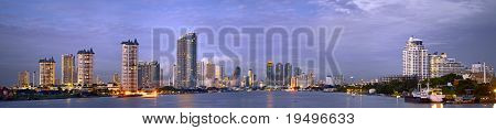 Night panoramic view of modern Bangkok near Taksin bridge