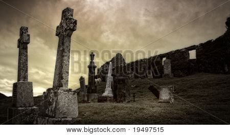 Spooky graveyard surrounding ancient ruin on Isle of Skye, Scotland