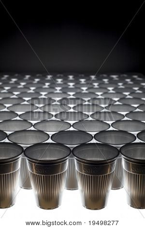 Arrangement of plastic cups forming a background pattern, angular view