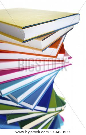 Macro of spiral stack of colorful real books on white background, top view.