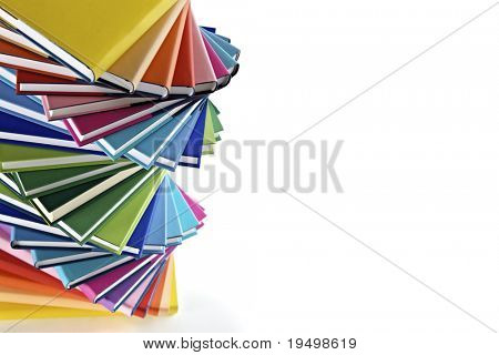 Spiral stack of multi-colored real books on white background, top view.