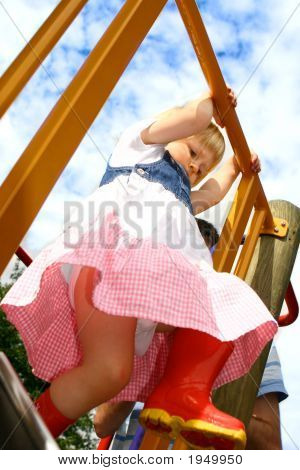 Girl Toddler Going Down The Slide