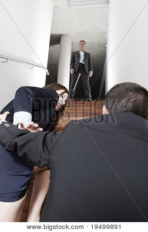 Boss watching male employee molesting female colleague in office.
