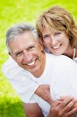 pic of elderly couple  - Mature couple smiling and embracing - JPG
