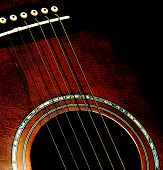 stock photo of acoustic guitar  - An acoustic six string guitar with the image contrast purposefully very high gives a jazz - JPG