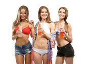 Beautiful young women in beachwear with beverages on white background poster