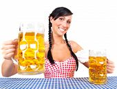 Original bavarian traditional beerfest woman with dirndl with beer maas glas celebrating the oktober