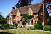 image of english cottage garden  - A traditional English country cottage brick built with manicured lawns - JPG