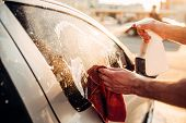 Male hand with tool for washing windows, car wash poster