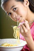Young Girl Enjoying Bowl Of Spaghetti poster