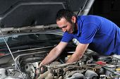 pic of car repair shop  - Car mechanic working on a car  - JPG