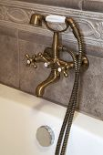 stock photo of mixing faucet  - The beautiful bronze faucet in a bathroom - JPG