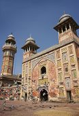 Rising pigeons at beautiful Wazir Khan Mosque in the old city center of Lahore, Pakistan