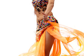 picture of belly-dance  - Photo of the dancing active woman in orange costume - JPG